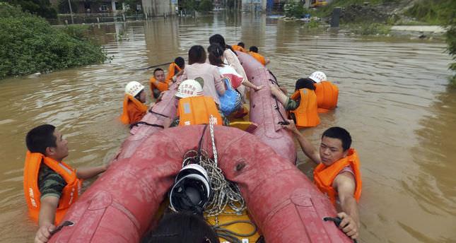 Dozens die in China floods