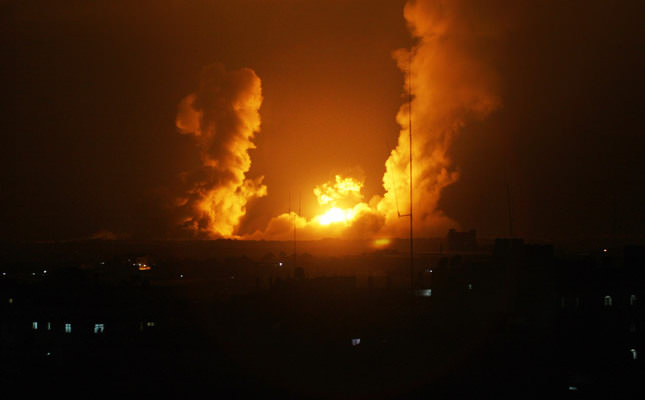 Israel bombs dozens of sites in Gaza after Israeli teens' bodies found