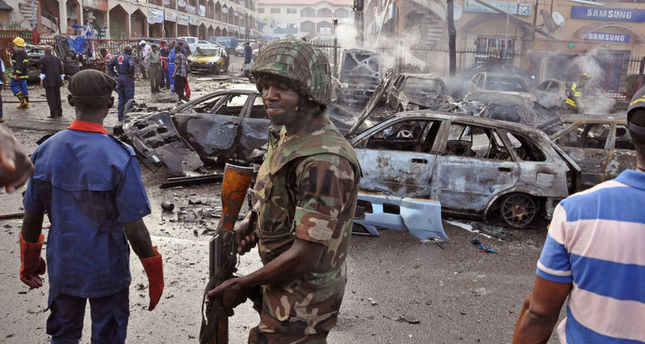 Bomb hits Nigeria market, girls' abduction suspect held