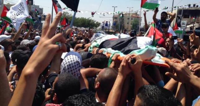 Palestinian fury at Israel boils at funeral for slain youth