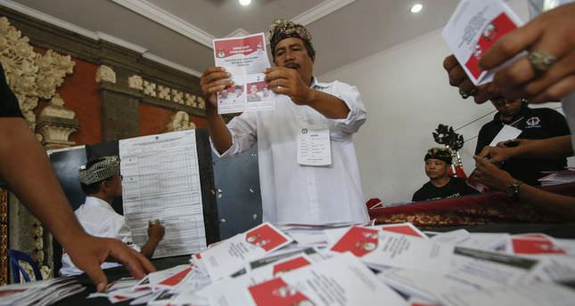 Both Indonesian presidential candidates claim victory