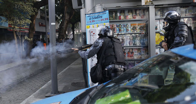Protestors and police clash before the final in Brazil
