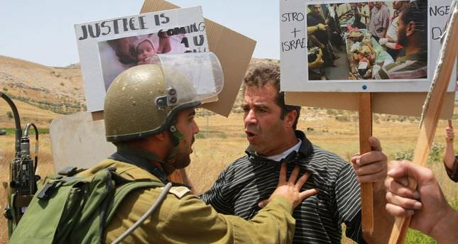Israel kills Palestinian stone-thrower, detains 18 in West Bank