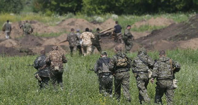 Clashes in Ukraine kill 12 civilians, injure 52