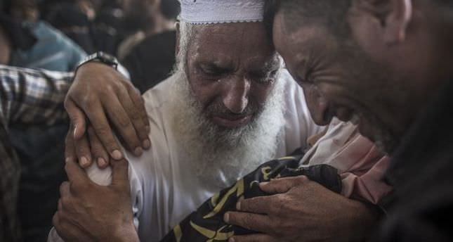 Three Gazans killed moments before truce, death toll hits 230