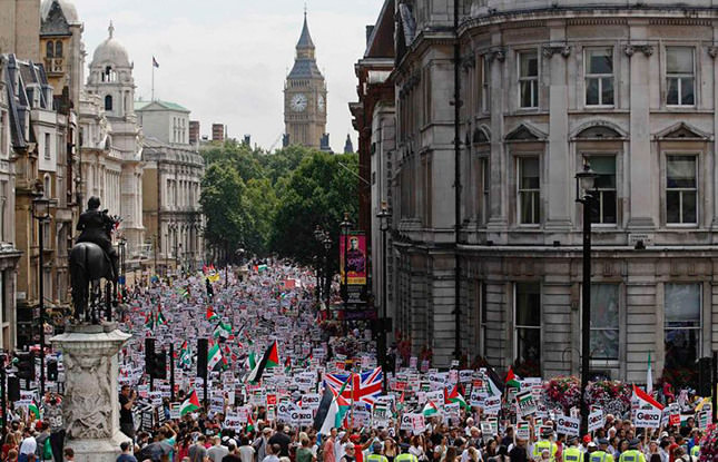 Tens of thousands march for Gaza in London, clashes in Paris