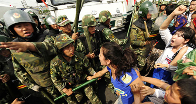 Uighur group says nearly 100 casualties in China clash