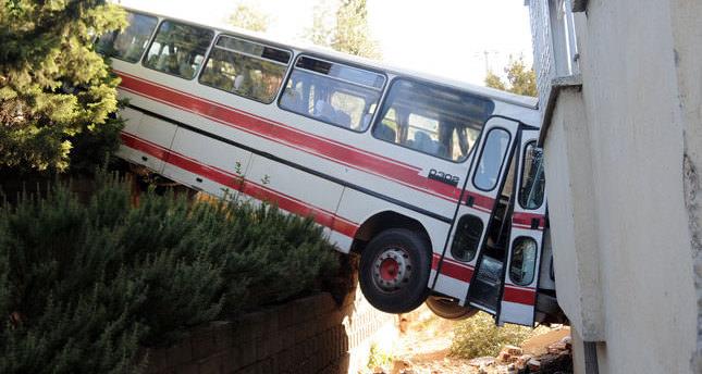 Bus crashes into balcony, 2 injured