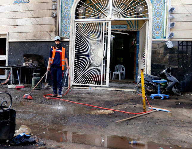 Suicide bombs kill at least 33 in Iraq's Baghdad, Karbala