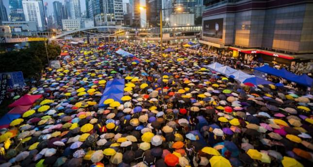 Hong Kong protesters hush for 87 secs to remember tear gas police fired
