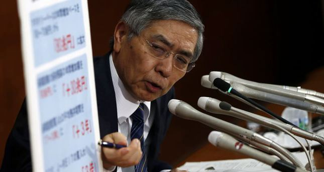 Japan expands stimulus to spur recovery, stave off deflation