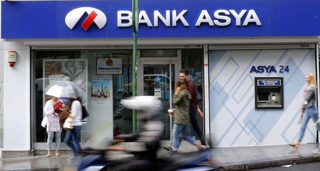 Bank Asya close 80 branches, fear bank runs