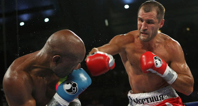 Kovalev outboxes veteran Hopkins to unify world titles