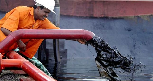 Oil prices hit record lows, focus on OPEC