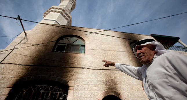Jewish settlers set West Bank mosque on fire