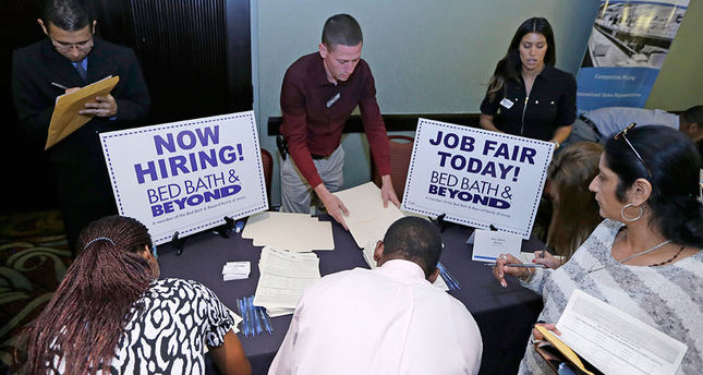Applications for US jobless aid climb to 290,000