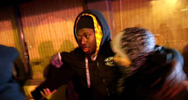 At least 18 injured in Ferguson-related protests