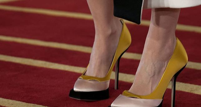 Men behave more favorably towards women with high-heeled shoes: study
