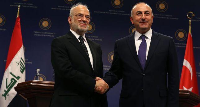 Iraqi PM Haider al-Abadi shaking hands with Turkish Foreign Minister CavusogluAA