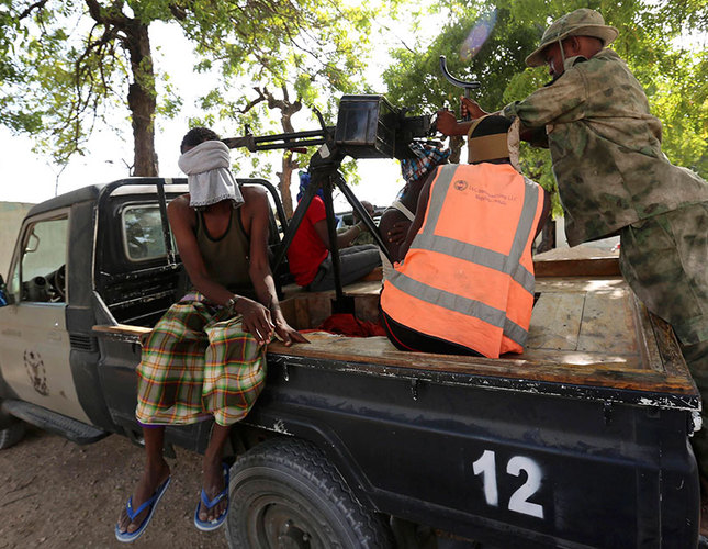 A blind-folded suspect is detained by Somalia security forces after attackers from the militant group Al-Shabaab invaded the African Union's Halane base on the edge of the Mogadishu International Airport on  December 26, 2014  Reuters