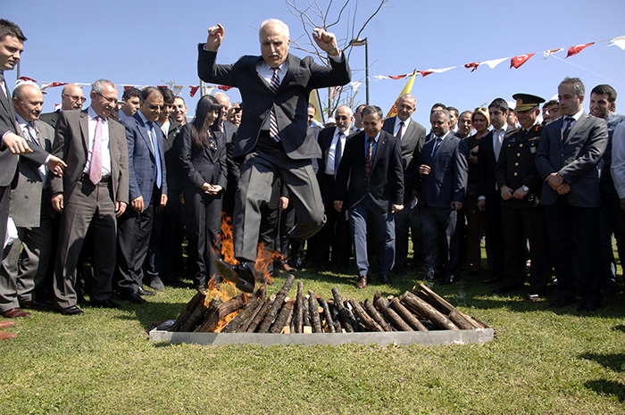 - Istanbul's former governor Huseyin Avni Mutlu jumps over the Nevruz fire during last year's celebrations in Istanbul