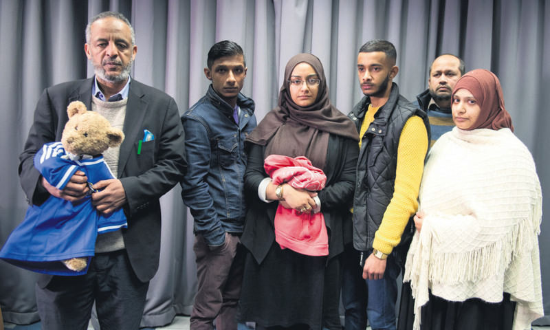 The families of missing British girls Amira Abase and Shamima Begum pose for a picture after being interviewed by the media in central London on Feb. 22.