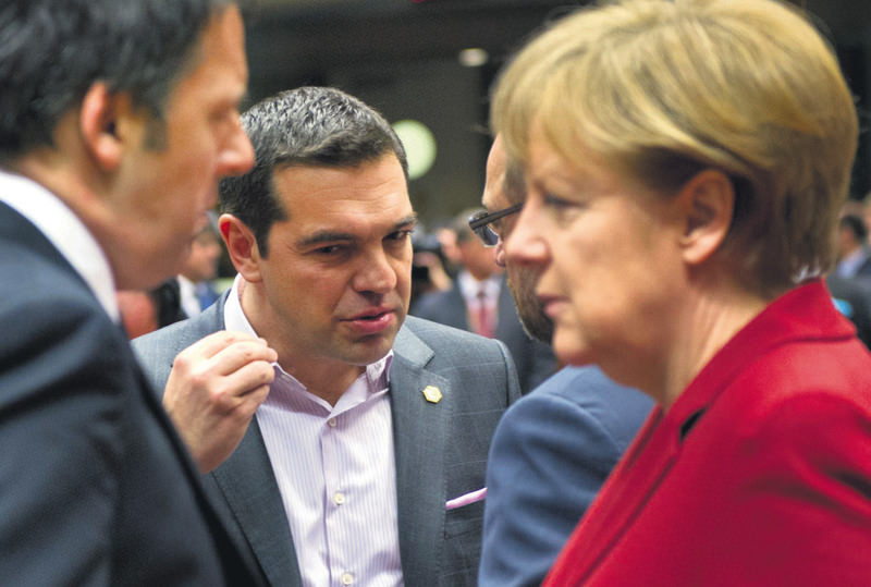 Greece's Prime minister Alexis Tsipras and Germany's Chancellor Angela Merkel met during the European Council summit on March 19, 2015 at the Council of the European Union Justus Lipsius building in Brussels.
