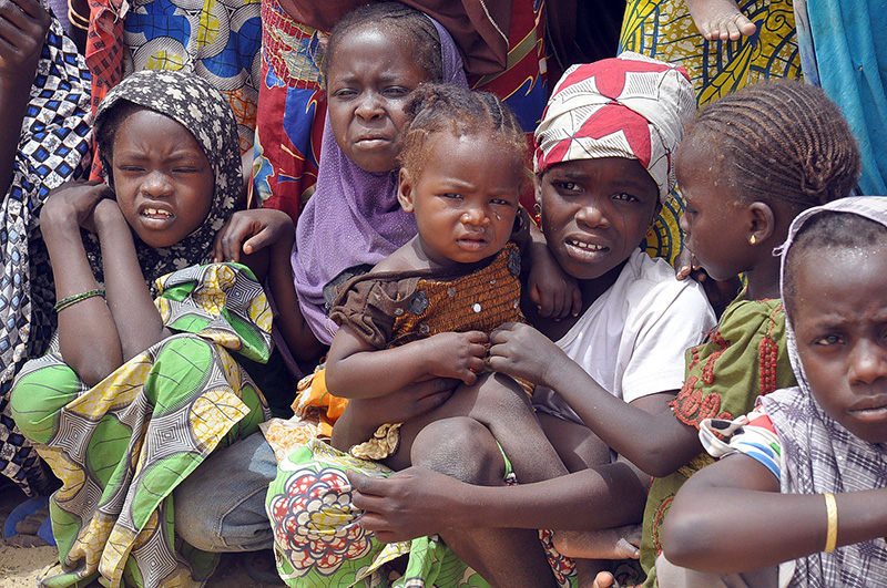Children fleeing from Boko Haram attacks gather at a refugee camp in Niger Republic on March 13, 2015  Photo: AFP