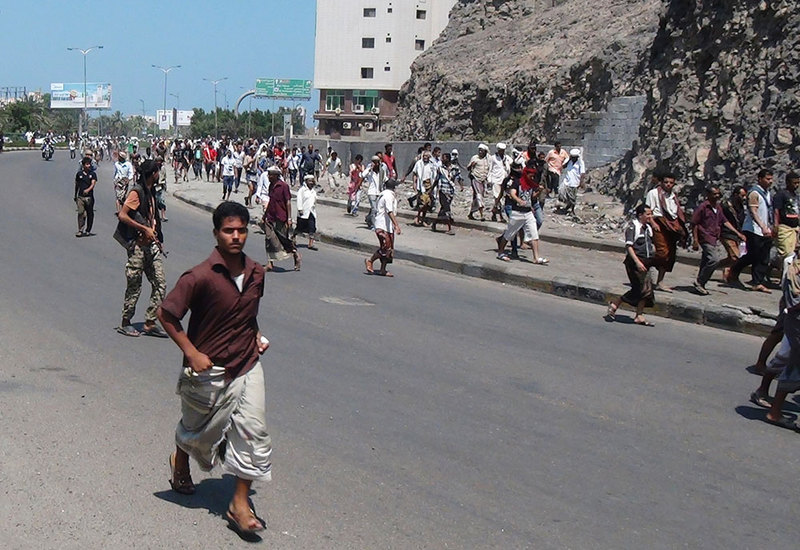People flee after a gunfire on a street in the southern port city of Aden, Yemen, on March 25, 2015  Photo: AP
