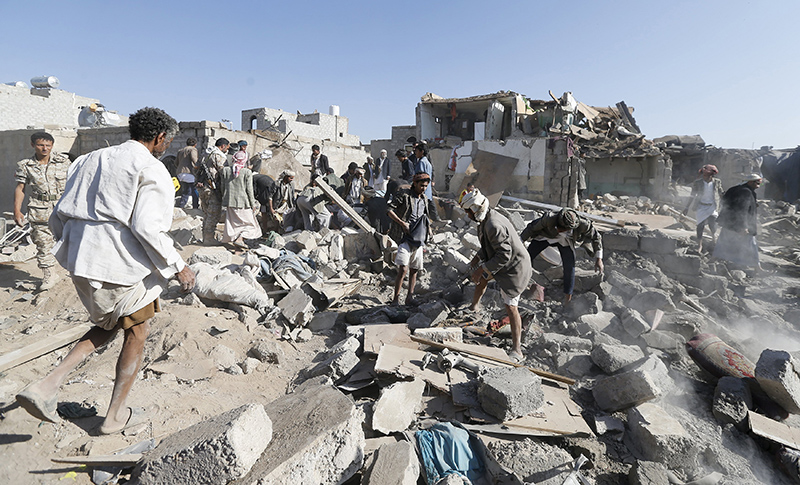People search for survivors under the rubble of houses destroyed by an air strike near Sanaa Airport Photo: Reuters