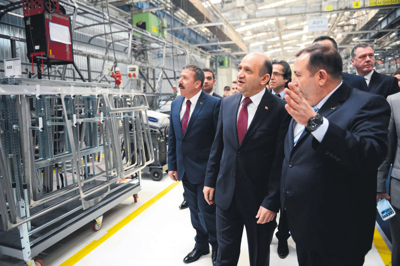 Technology Minister Iu015fu0131k attended the openning ceremony of the NEOPLAN production plant yesterday, where he was informed about the factory by MAN Turkey General Manager Yavuz.