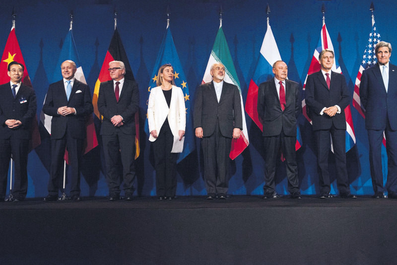 The representatives of the P5+1 and Iran pose after the framework accord was announced.