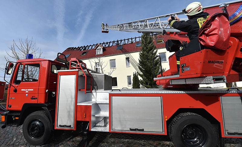 Firefighters in front of the refugee hostel in Troeglitz, Germany