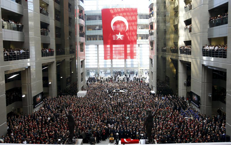 People attend the funeral ceremony of prosecutor Mehmet Selim Kiraz at the Justice Palace in Istanbul April 1, 2015