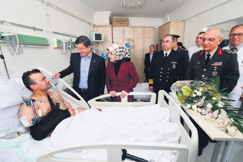 Prime Minister Davutou011flu visiting the four soldiers, who were injured in the clashes with PKK militants. The soldiers were later transfered to a military hospital in capital Ankara.