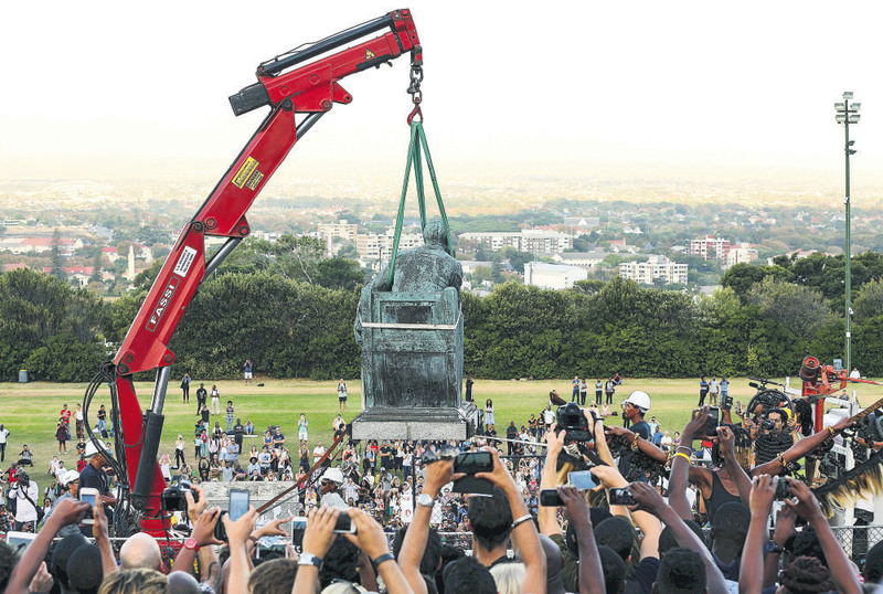 South African students cheer as the statue of Cecil John Rhodes is removed from the University of Cape Town on April 9. Rhodes in seen as the symbol of oppression meted out by Whites, who believed they were separate, superior and fully evolved.