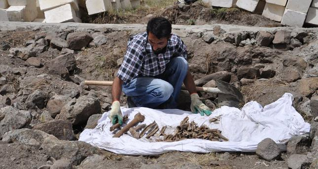 Excavation in the site where 24 people from the Baran and Canan families were claimed to be burned to death in the 1938 airstrike in Dersim (IHA Photo)