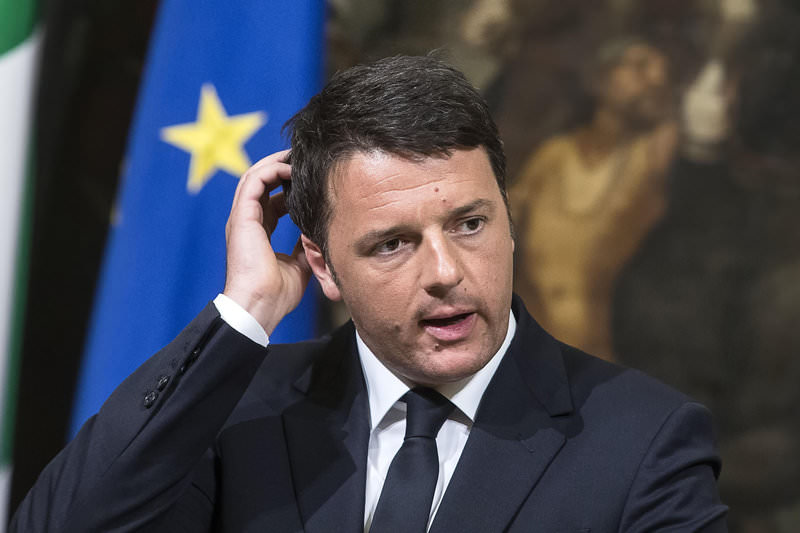 Italian PM Matteo Renzi talks to journalists during a press conference he held after a meeting with his top ministers in an emergency strategy session, in Rome, Sunday, April 19, 2015 (AP Photo)