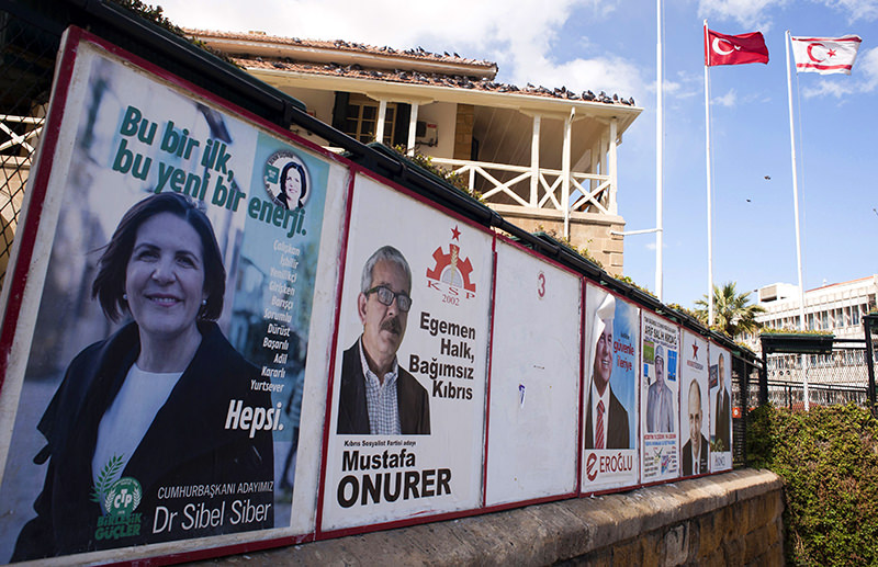 Posters bearing portraits of candidates running for the upcoming election in the Turkish Republic of Northern Cyprus (AFP Photo)