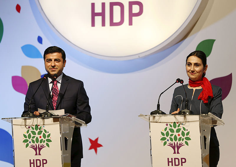 Co-chairs of the pro-Kurdish Peoples' Democratic Party (HDP), Selahattin Demirtau015f (L) and Figen Yu00fcksekdau011f, attend a meeting to announce their party's manifesto for the upcoming general election, in Istanbul on April 21, 2015 (Reuters Photo)