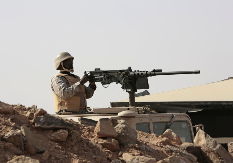 A Saudi soldier sits on top of an armour vehicle as he aims his weapons, on the border with Yemen, at a military point in Najran, Saudi Arabia  (AP Photo)