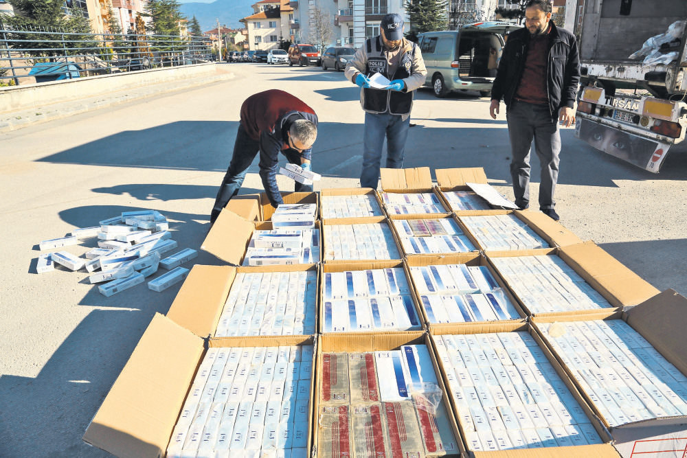 Police in the city of Bolu sorting out smuggled cigarettes found in a truck. Cigarette smuggling is a common concern for both Turkey and Bulgaria.