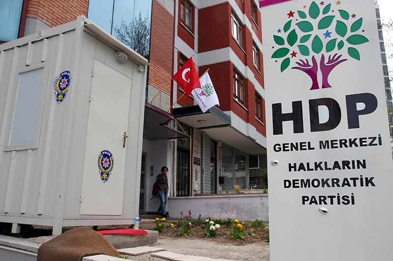 Bullet holes mark the sign after assailants opened fire on the headquarters of the pro-Kurdish Peoplesu2019 Democratic Party, (HDP) early on April 18, 2015 in Ankara, Turkey (AFP Photo)