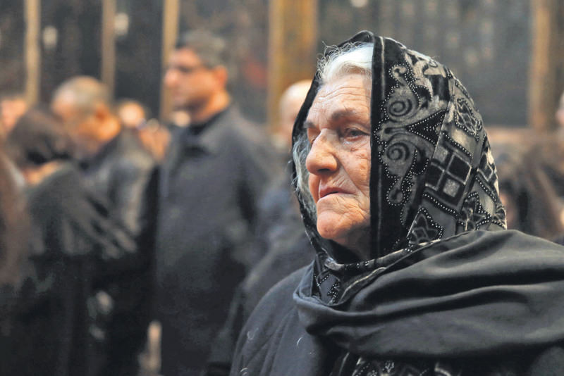 A member of the Armenian community attends a special at the Armenian St. James Cathedral in Jerusalem's Old City, to commemorate the 1915 incidents.