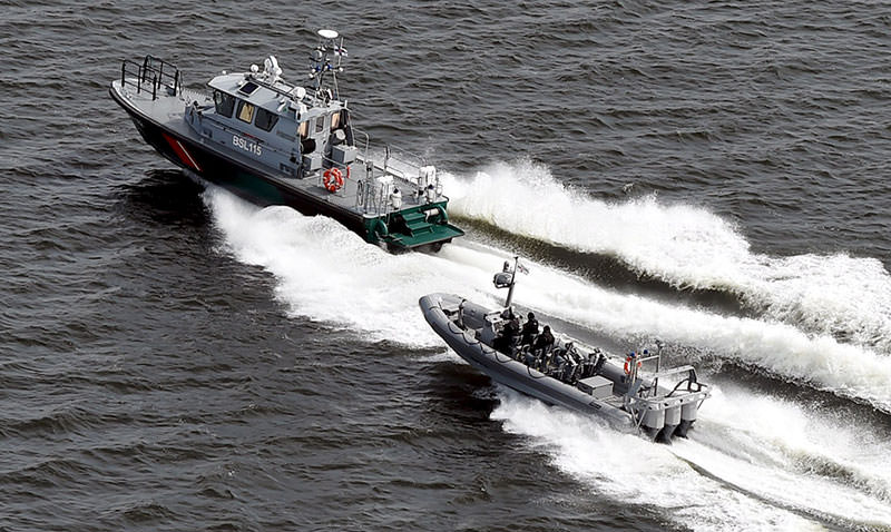 Boats of the Finnish Border Guard patrol the waters outside Helsinki Tuesday, April 28, 2015 (AP Photo)