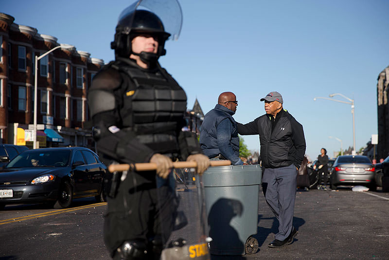 U.S. Rep. Elijah Cummings, D-Md., right, meets with residents cleaning up, Tuesday, April 28, 2015, in Baltimore, in the aftermath of rioting following Monday's funeral of Freddie Gray, who died in police custody (AP Photo)