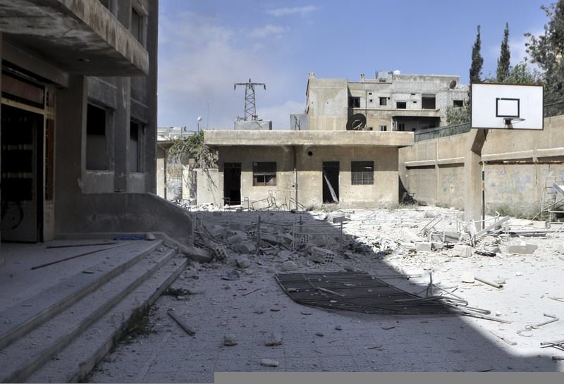 A view of the damage at a school, after what activists said were eight barrel bombs thrown by forces loyal to Syria's President Bashar Al-Assad, in Yarmouk camp April 14, 2015 (Reuters Photo)