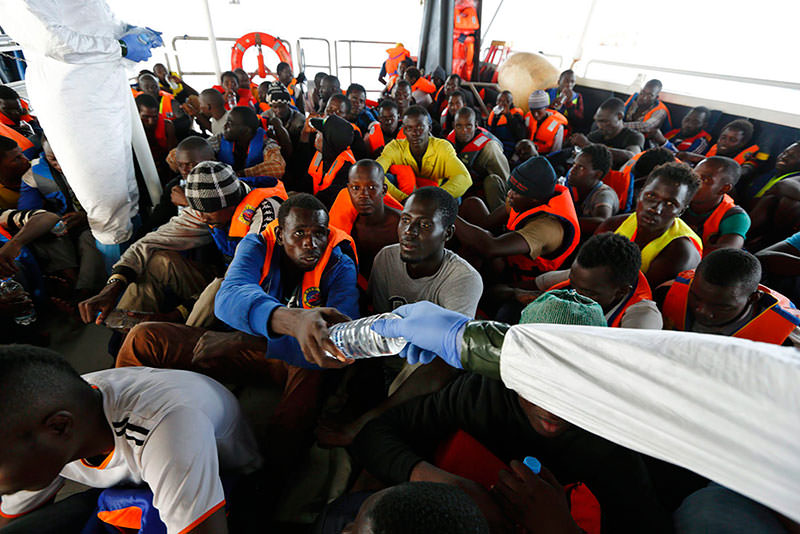 A handout picture made available on 02 May 2015 of 105 refugees rescued from a rubber raft on the 'Phoenix', a ship belonging to the Migrant Offshore Aid Station (MOAS), off the shores of the island of Lampedusa, Italy, 04 October 2014 (EPA Photo)