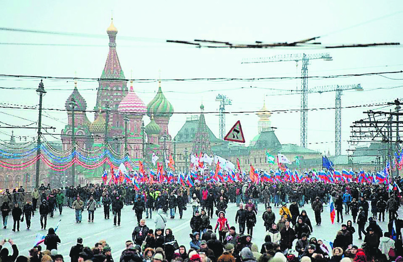 Russian opposition supporters march in memory of murdered Kremlin critic Boris Nemtsov in central Moscow.