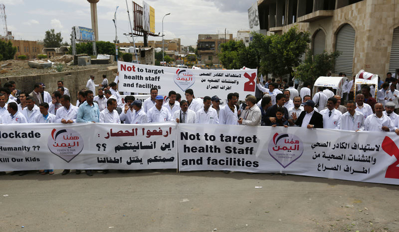 Yemeni health workers gather during a rally to demand the lifting of the blockade on Yemen, in front of the U.N. building in Sanaa, Yemen, Thursday, May 7, 2015 (AP Photo)